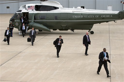 Secret Service agents arrive at Gary/Chicago International Airport ahead of the arrival of President Barack Obama, on Thursday  (AP Photo/Evan Vucci)