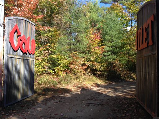Gates that lead to the Gauntlet Haunted Night Ride at Harvest Hills Farm in Mechanic Falls, Me.  (AP Photo/Patrick Whittle)