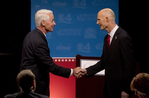 Democratic challenger, former Republican Gov. Charlie Crist, left, and Florida Republican Gov. Rick Scott, shake hands after participating in their second debate, Wednesday  (AP Photo/Wilfredo Lee, Pool)