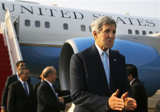 U.S. Secretary of State John Kerry arrives at the airport in Jakarta, Indonesia  (AP Photo/Brian Snyder, Pool)