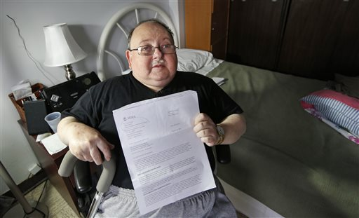 Belle Harbor Manor resident Robert Rosenberg, 61, who suffers from a spinal disability and has other chronic health problems, sits in his room in an assisted living facility in New York  (AP Photo/Kathy Willens)