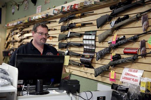 Steven King works behind the counter at at Metro Shooting Supplies, in Bridgeton, Mo.  (AP Photo/Jeff Roberson)