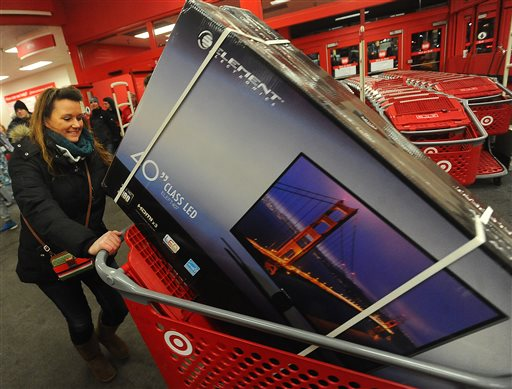 Lori Karn, of Harrisburg, heads for the door after shopping the Black Friday sale at Target in Sioux Falls, S.D.  (AP Photo/The Argus Leader, Jay Pickthorn)