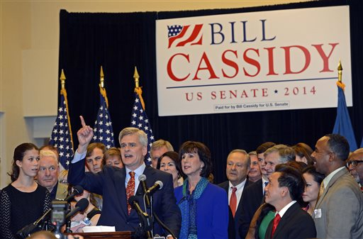 Surrounded by family and friends, Louisiana Senator elect Bill Cassidy thanks supporters for their help during his election watch party in Baton Rouge, La., Saturday.  (AP Photo/Bill Feig)