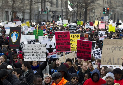 Demonstrators march on Pennsylvania Avenue toward Capitol Hill in Washington, Saturday  (AP Photo/Jose Luis Magana)