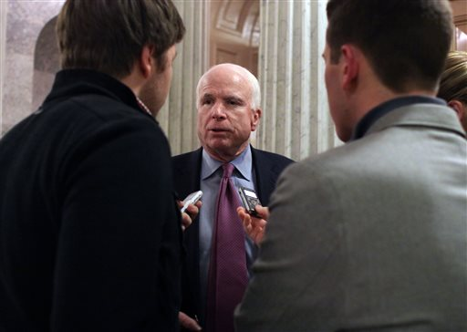 Sen. John McCain (R-AZ) talks with reporters after the Senate voted on a $1.1 trillion spending bill to fund the government through the next fiscal year on on Saturday (AP Photo/Lauren Victoria Burke)