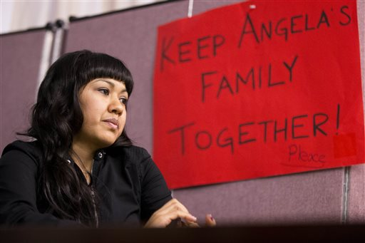 Angela Navarro who has been living in the U.S. with her American-born children despite a deportation order issued 10 years ago sits at the West Kensington Ministry church in Philadelphia (AP Photo/Matt Rourke)