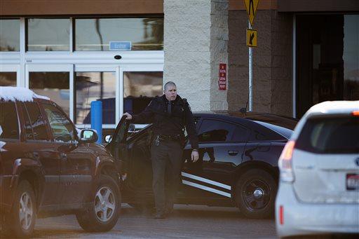 An Idaho State Patrol officer arrives at Wal-Mart in Hayden, Idaho, Tuesday  (AP Photo/Coeur d'Alene Press, Tess Freeman)