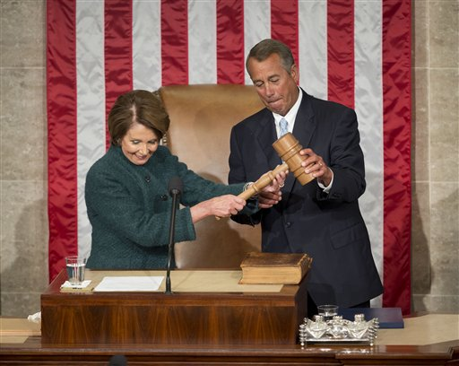 House Speaker John Boehner of Ohio, is handed the gavel from House Minority Leader Nancy Pelosi of Calif. after being re-elected for a third term to lead the 114th Congress, as Republicans assume full control for the first time in eight years, Tuesday,   (AP Photo/Pablo Martinez Monsivais )