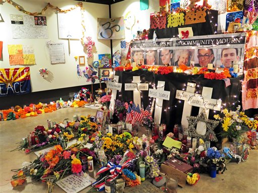 Flowers, teddy bears and inspirational posters line a room at the Arizona History Museum in Tucson in this 2015 photo.  (AP Photo/Astrid Galván)