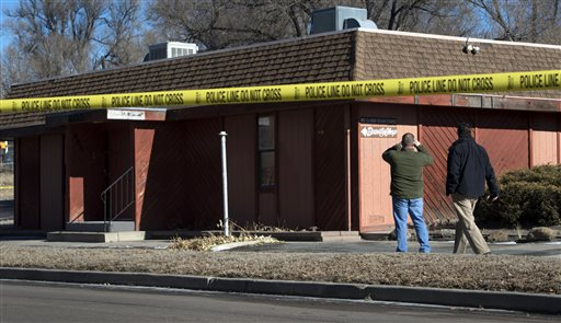 Colorado Springs police officers investigate the scene of an explosion in Colorado Springs, Colo.  (AP Photo/The Colorado Springs Gazette, Christian Murdock )