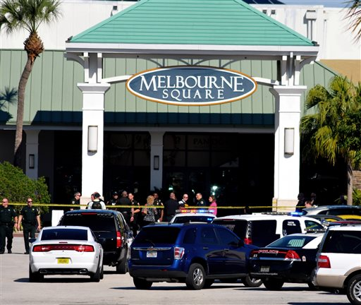 Emergency personnel respond to the scene of a shooting at the Melbourne Square Mall (AP Photo/Florida Today, Malcolm Denemark)