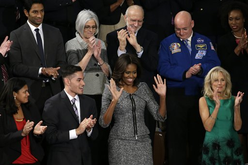 First lady Michelle Obama acknowledges applause on  Capitol Hill in Washington  (AP Photo/Pablo Martinez Monsivais)