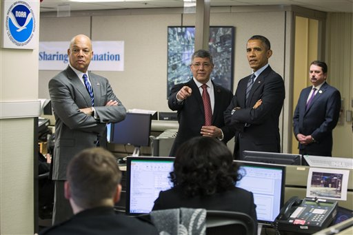 President Barack Obama, right, and Secretary of Homeland Security Jeh Johnson, left, take a tour of the National Operations Center before Obama delivered remarks on his FY2016 budget proposal. (AP Photo/Evan Vucci)