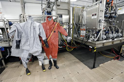 Protective suits for workers used in chemical munitions destruction hang inside the Pueblo Chemical Depot, east of Pueblo, in southern Colorado. (AP Photo/Brennan Linsley)