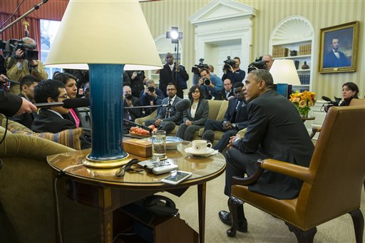 """President Barack Obama meets with a group of """"Dreamers"""" in the Oval Office of the White House in Washington.  (AP Photo/Evan Vucci)"""