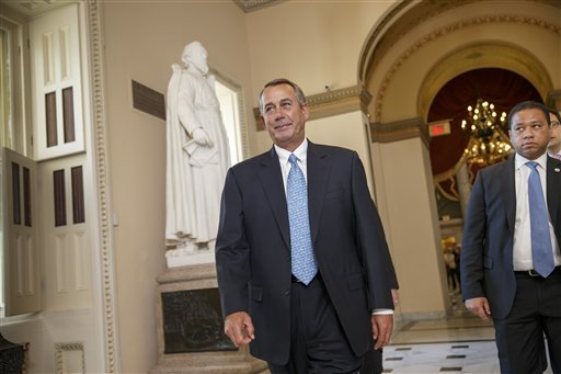 House Speaker John Boehner of Ohio walks to the House chamber on Capitol Hill.  (AP Photo/J. Scott Applewhite)