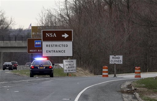 A Maryland State Police cruiser sits at a blocked southbound entrance on the Baltimore-Washington Parkway that accesses the National Security Agency, Monday,  (AP Photo/Patrick Semansky)
