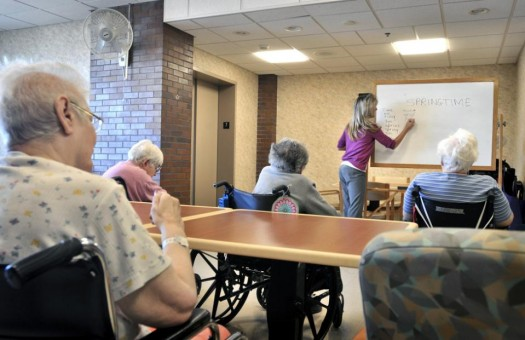 Tina Reese leads a word game for residents at a nursing home in Lancaster, Pa.  (AP Photo/Intelligencer Journal, Dan Marschka)