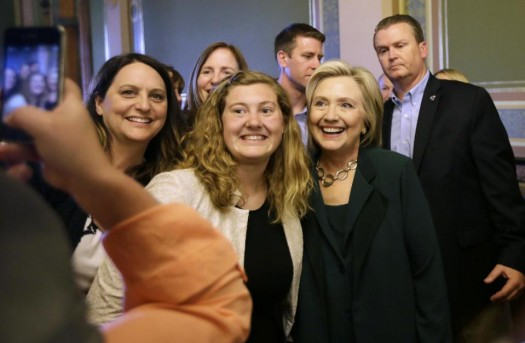 Democratic presidential candidate Hillary Rodham Clinton poses for a photo with Simpson College student MacKenzie Bills.  (AP Photo/Charlie Neibergall)