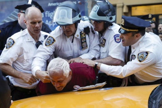 New York Police Department officers detain a protester during a march through the Manhattan borough of New York City. (REUTERS/Mike Segar)