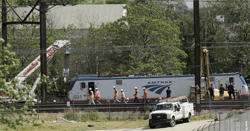 Emergency and transportation personnel work at the scene of a deadly train wreck, Wednesday. (AP Photo/Matt Slocum)