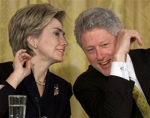 President Bill Clinton and first lady Hillary Rodham Clinton talk during the White House Conference on Philanthropy in the East Room of the White House in Washington in 1999.  (AP Photo/Khue Bui)