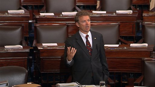 Sen. Rand Paul, R-Ky., and a Republican presidential contender, speaks on the floor of the U.S. Senate Wednesday  at the Capitol in Washington, during a long speech opposing renewal of the Patriot Act.  (Senate TV via AP)