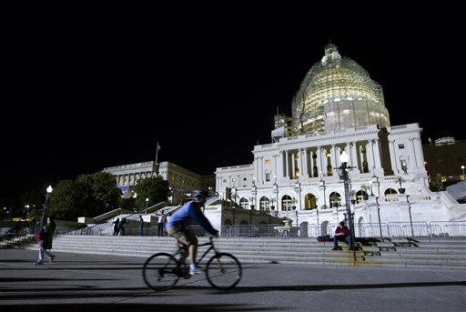 The U.S. Capitol is illuminated at night as the Senate continues to work late Friday.  (AP Photo/Jose Luis Magana)