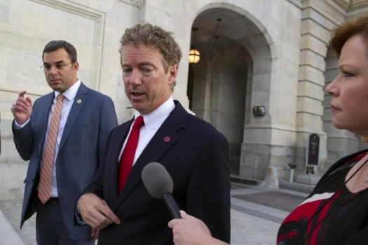Sen. Rand Paul, R-Ky., talks with a reporter as he leaves the Capitol following his address to the Senate in Washington, Sunday.  (AP Photo/Cliff Owen)