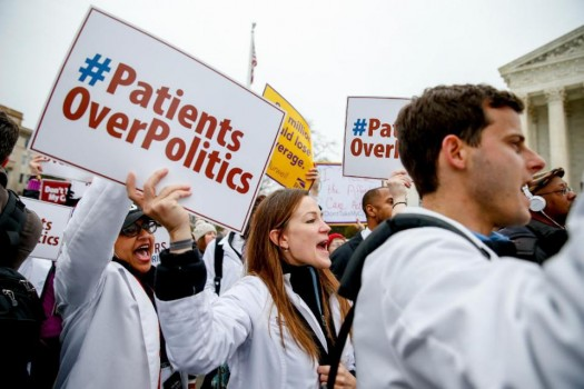 Demonstrators chant during  health care rally outside the Supreme Court in Washington.  (AP Photo/Andrew Harnik)
