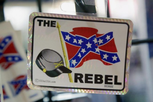 Confederate flag themed stickers are displayed at Arkansas Flag and Banner in Little Rock, Ark. (AP Photo/Danny Johnston)