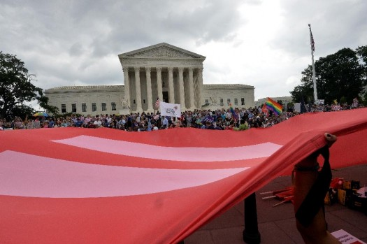 People wave a giant equality flag in celebration outside the Supreme Court after its nationwide decision on gay marriage in Washington, DC  (AFP Photo/Mladen Antonov)