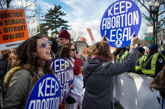 Pro-choice activists in front of the US Supreme Court in Washington, DC. (AFP Photo/Jim Watson)