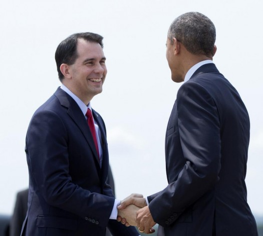 President Barack Obama is greeted by Wisconsin Gov. Scott Walker as he arrives on Air Force One at La Crosse Regional Airport, Thursday.  (AP Photo/Carolyn Kaster)