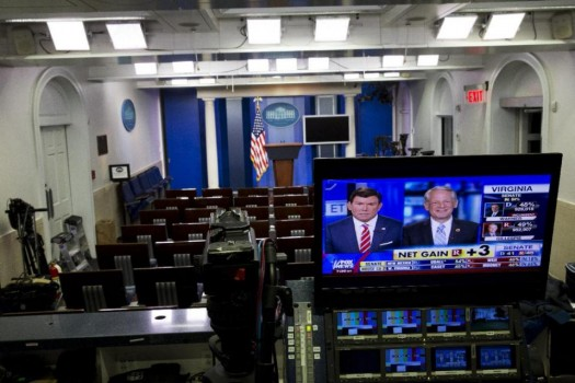 Fox News reports Republican gains in the Senate in an empty White House briefing room as poll numbers begin to pour in on election day in Washington. (AP Photo/Jacquelyn Martin)