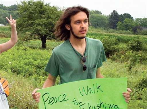 Alexander Ciccolo participates in a peace walk through Brighton, Ontario. (Dave Fraser/Northumberland News via AP)