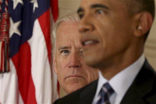 Vice President Joe Biden listens as President Barack Obama delivers remarks in the East Room of the White House in Washington.  (AP Photo/Andrew Harnik, Pool)