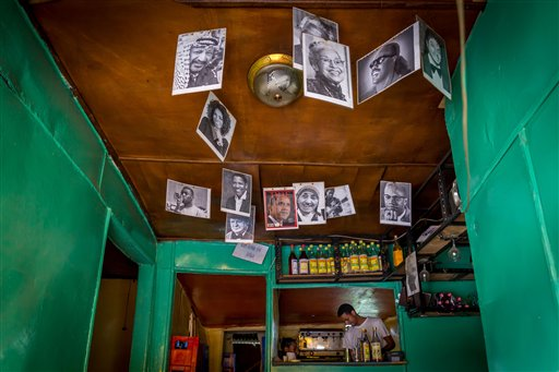 In this photo taken Saturday June 20, 2015, a portrait of U.S. President Barak Obama is displayed with other famous people in the National Cafe in Addis Ababa, Ethiopia. Barack Obama, the United States' first African-American president, has captured the imagination of people across the continent where his face shows up on billboards, backpacks, T-shirts and restaurants.  On Friday, July 24, 2015 Obama will be visiting Kenya, where his father was born, for a summit on entrepreneurship before heading to Ethiopia to address leaders at the African Union headquarters. Wherever he goes, large crowds are expected to gather and cheer him. (AP Photo/Mulugeta Ayene)