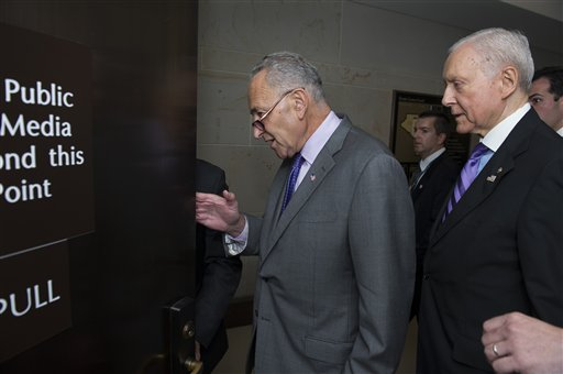 FILE - In this July 22, 2015, file photo Sens. Charles Schumer, D-N.Y., left, and Orrin Hatch, R-Utah., arrive for a classified briefing by Secretary of State John Kerry on Iran, on Capitol Hill in Washington. Schumer is breaking with President Barack Obama and will oppose the Iran nuclear deal. (AP Photo/Cliff Owen, File)