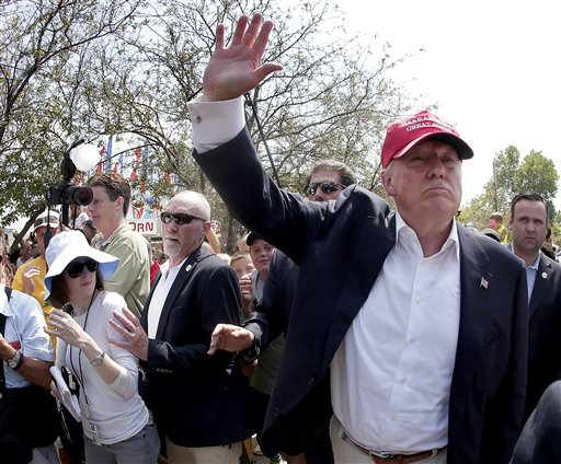 Republican presidential candidate Donald Trump waves to the crowd at the Iowa State Fair Saturday, Aug. 15, 2015, in Des Moines. (AP Photo/Charlie Riedel)