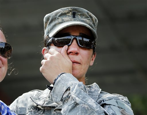U.S. Army First Lt. Alessandra Kirby wipes away a tear after a Ranger School graduation ceremony, Friday, Aug. 21, 2015, at Fort Benning, Ga. First Lt. Shaye Haver and Capt. Kristen Griest became the first female soldiers to complete the course and receive their Ranger tabs. (AP Photo/John Bazemore)