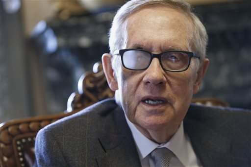 "File- This March 4, 2015, file photo shows Senate Minority Leader Harry Reid of Nev. talking about his future and the agenda of the Democrats who are now in the minority, during an interview in Washington. Reid says he's throwing his full support behind President Barack Obama's nuclear agreement with Iran. In a message on his Twitter account, the Nevada senator said Sunday, Aug. 23, 2015, he strongly supports ""the historic agreement with Iran and will do everything in my power to ensure that it stands."" Reid was wearing special glasses as part of his recovery from injuries suffered in a violent exercise accident in January.  (AP Photo/J. Scott Applewhite, File)"