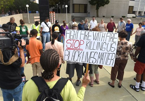 In this Friday, Aug. 28, 2015 photo, dozens of people gather during a rally outside the Frank Murphy Hall of Justice in Detroit regarding the shooting death of Terrance Kellom by an U.S. Immigration and Customs Enforcement (ICE) officer in April 2015. As the Black Lives Matter movement gains more public attention, there are questions being raised about who's in charge of the movement and what its long-term goals are. (Max Ortiz/The Detroit News via AP)