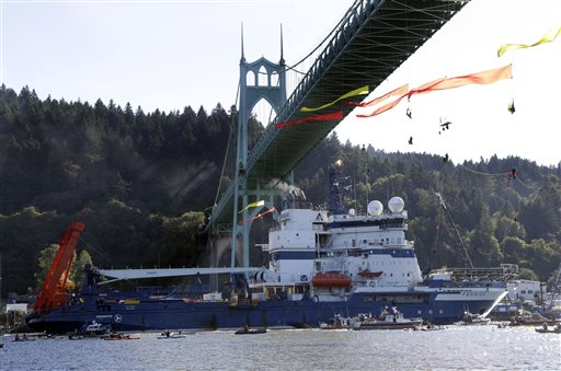File - In this July 30, 2015 file photo, the Royal Dutch Shell PLC icebreaker Fennica heads up the Willamette River under protesters hanging from the St. Johns Bridge on its way to Alaska in Portland, Ore. (AP Photo/Don Ryan, File)