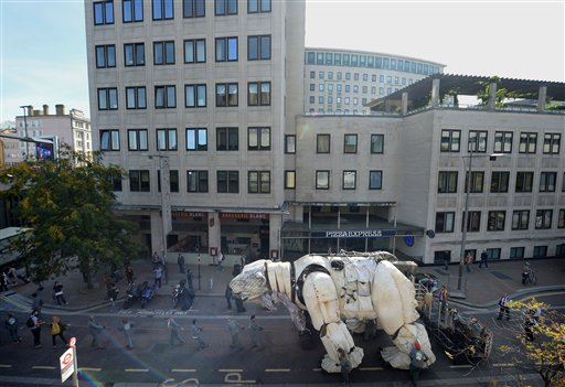 Puppeteers transport Aurora, the double decker bus sized polar bear, from in front of Shell HQ in London as Greenpeace activists celebrate Royal Dutch Shell's decision to stop Arctic oil drilling. Tuesday Sept. 29, 2015. Now Shell has announced its Arctic exit, the bear will be transported to Paris where the nations of the world will soon gather to negotiate a deal on climate change. See PA story ENVIRONMENT Shell. (Anthony Devlin/PA via AP) UNITED KINGDOM OUT NO SALES NO ARCHIVE