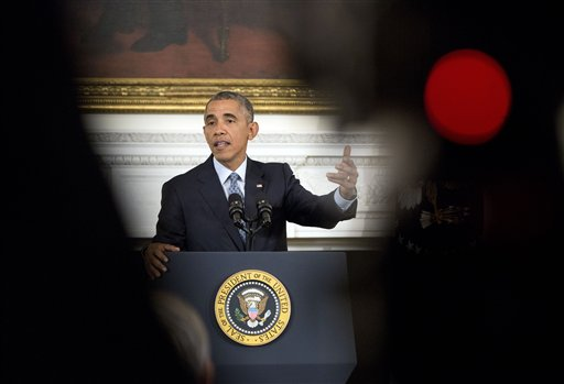 President Barack Obama gestures as he answers question during a news conference in the State Dining Room of the White House in Washington, Friday, Oct. 2, 2015. (AP Photo/Pablo Martinez Monsivais)
