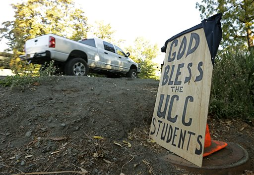 A sign honoring those killed in a fatal shooting at Umpqua Community College, is displayed Friday, Oct. 2, 2015, in Roseburg, Ore.  Armed with multiple guns, Chris Harper Mercer, walked into a class at the community college, Thursday, and opened fire, killing several and wounding others.  (AP Photo/Rich Pedroncelli)