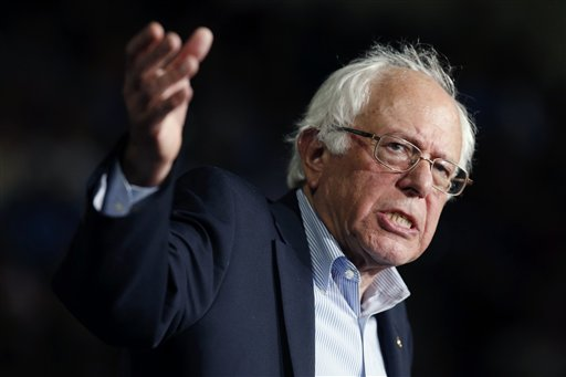 In this photo taken Oct. 3, 2015, Democratic presidential candidate, Sen. Bernie Sanders, I-Vt,  speaks during a campaign rally in Springfield, Mass. Hillary Rodham Clinton goes out of her way to praise her chief rival, Vermont independent Sen. Bernie Sanders, for his advocacy on the campaign trail. But she is beginning to point out their differences. But their differences is beginning to emerge ahead of next week's first Democratic presidential debate in Las Vegas, when they are both expected to face questions about what separates them.  (AP Photo/Michael Dwyer)