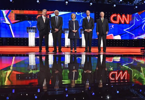 Democratic presidential candidates from left, former Virginia Sen. Jim Webb, Sen. Bernie Sanders, of Vermont, Hillary Rodham Clinton, former Maryland Gov. Martin O'Malley, and former Rhode Island Gov. Lincoln Chafee take the stage before the CNN Democratic presidential debate Tuesday, Oct. 13, 2015, in Las Vegas. (AP Photo/David Becker)